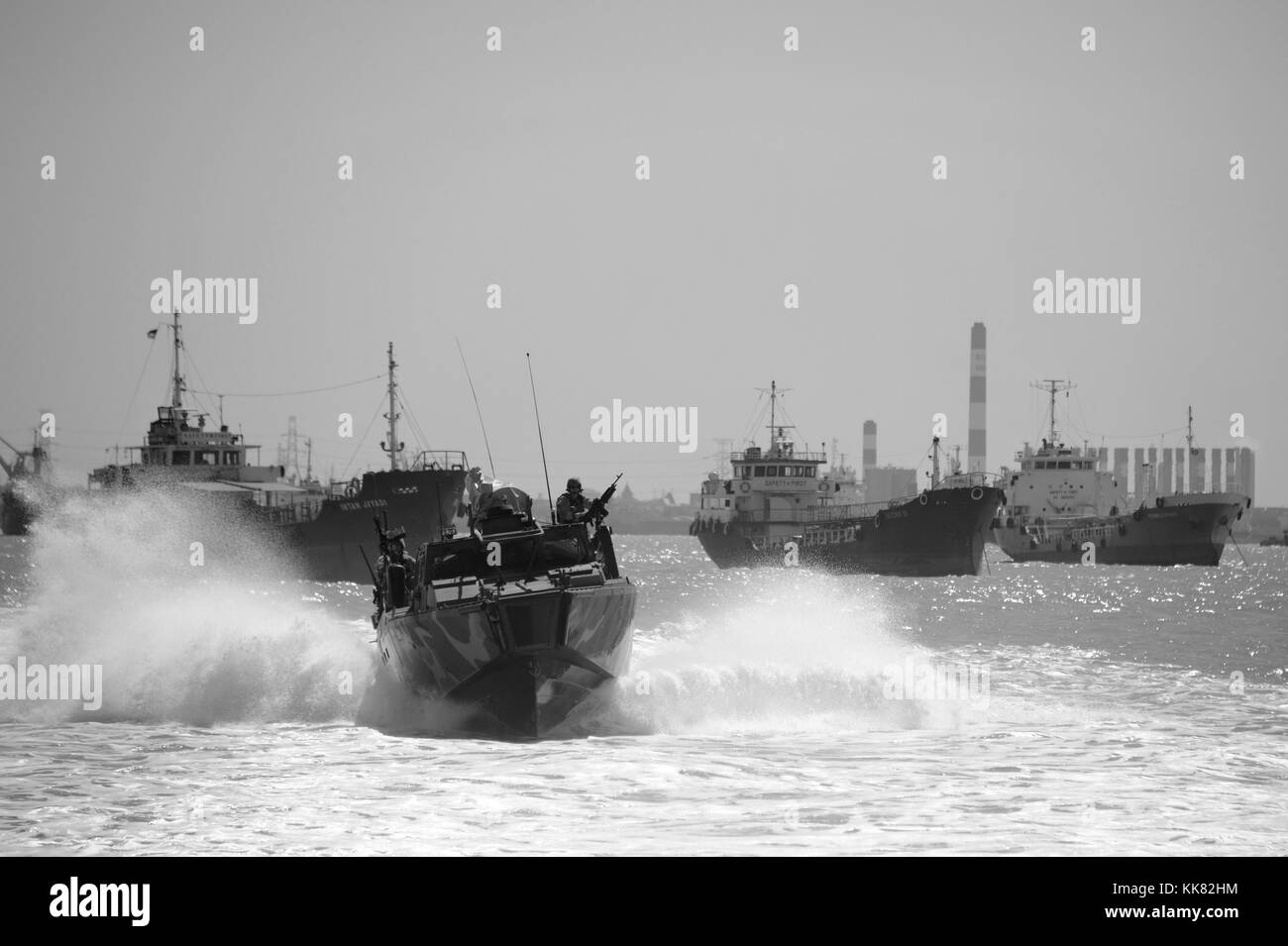 Sailors assigned to Coastal Riverine Squadron CRS 3 transit aboard a riverine command boat to Surabaya, Indonesia Stock Photo