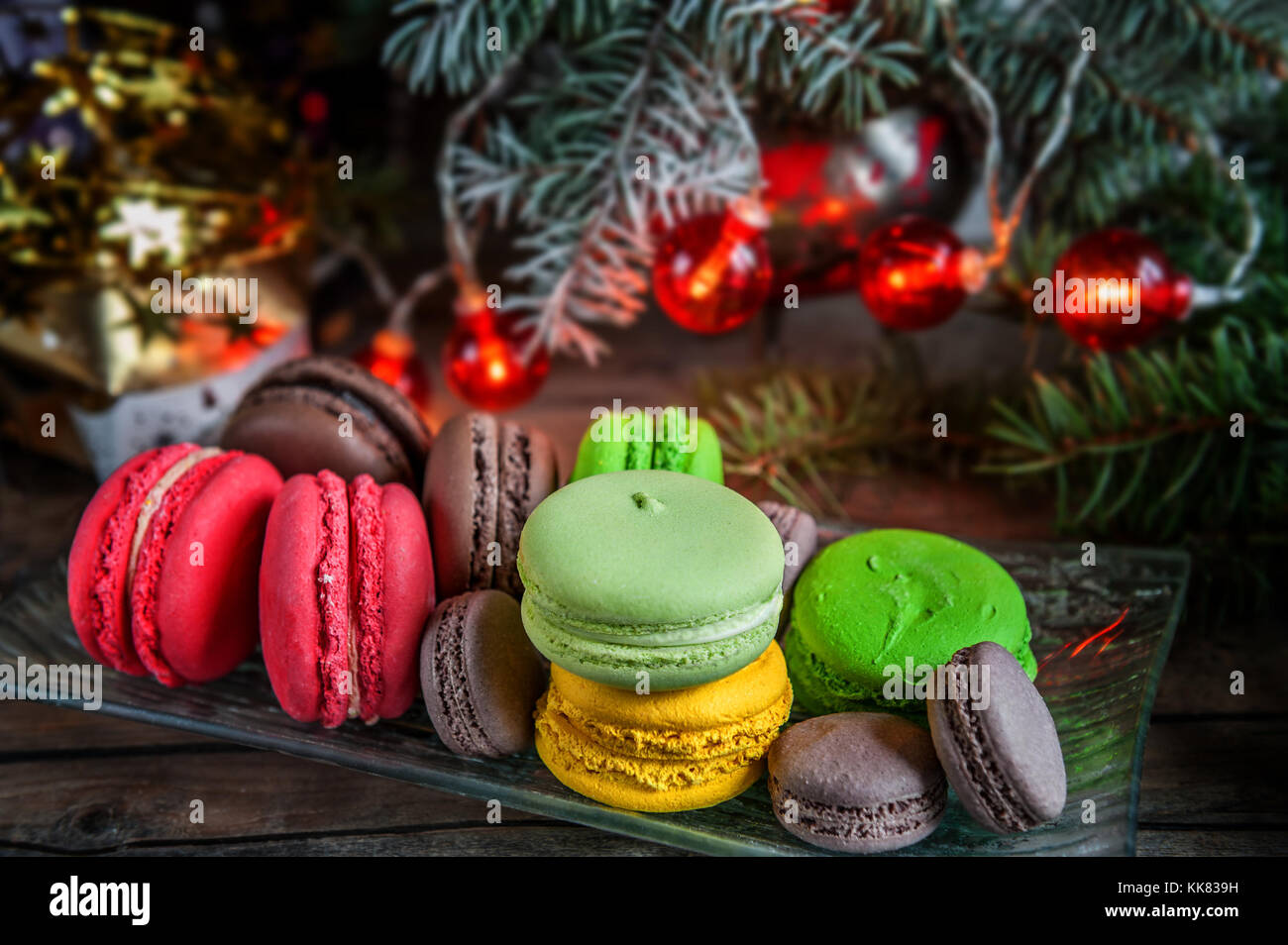 Fresh Red Macaroons At The Christmas Table With The Garland On The