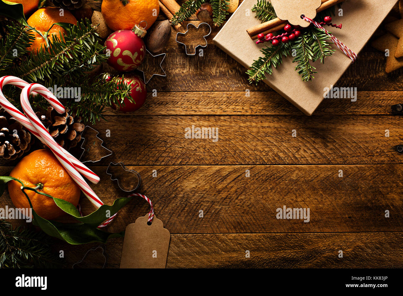 Christmas background with oranges, candy canes and decorations - Stock Image