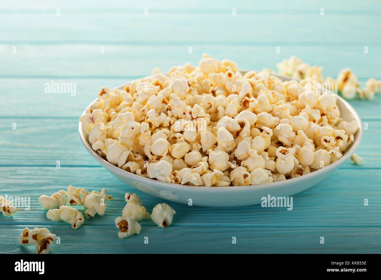 Cheddar cheese popcorn in a white bowl - Stock Image