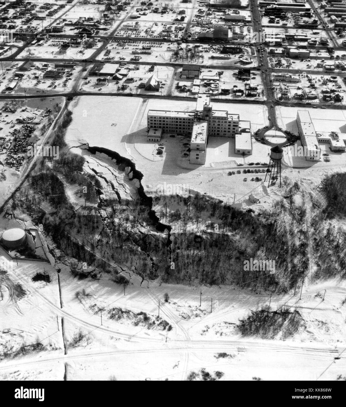 Overhead view of a landslide from the March 27, 1964 Alaska earthquake. The landslide occurred next to this hospital - Stock Image
