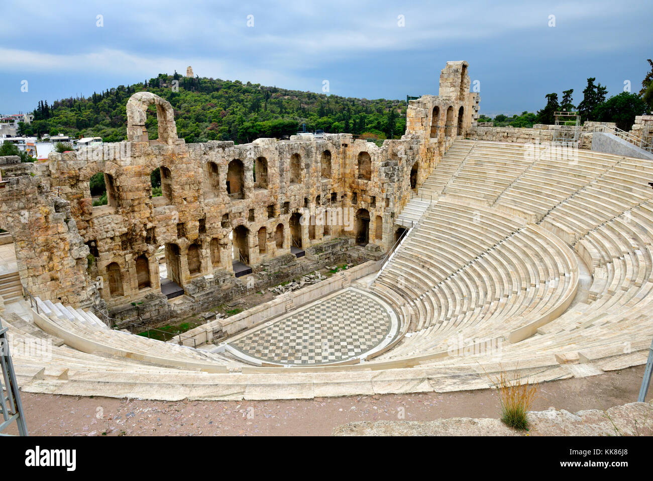 Open air amphitheater Odeon of Herodes Atticus (built  161AD, restored 1950), Acropolis of Athens. Used for performances - Stock Image