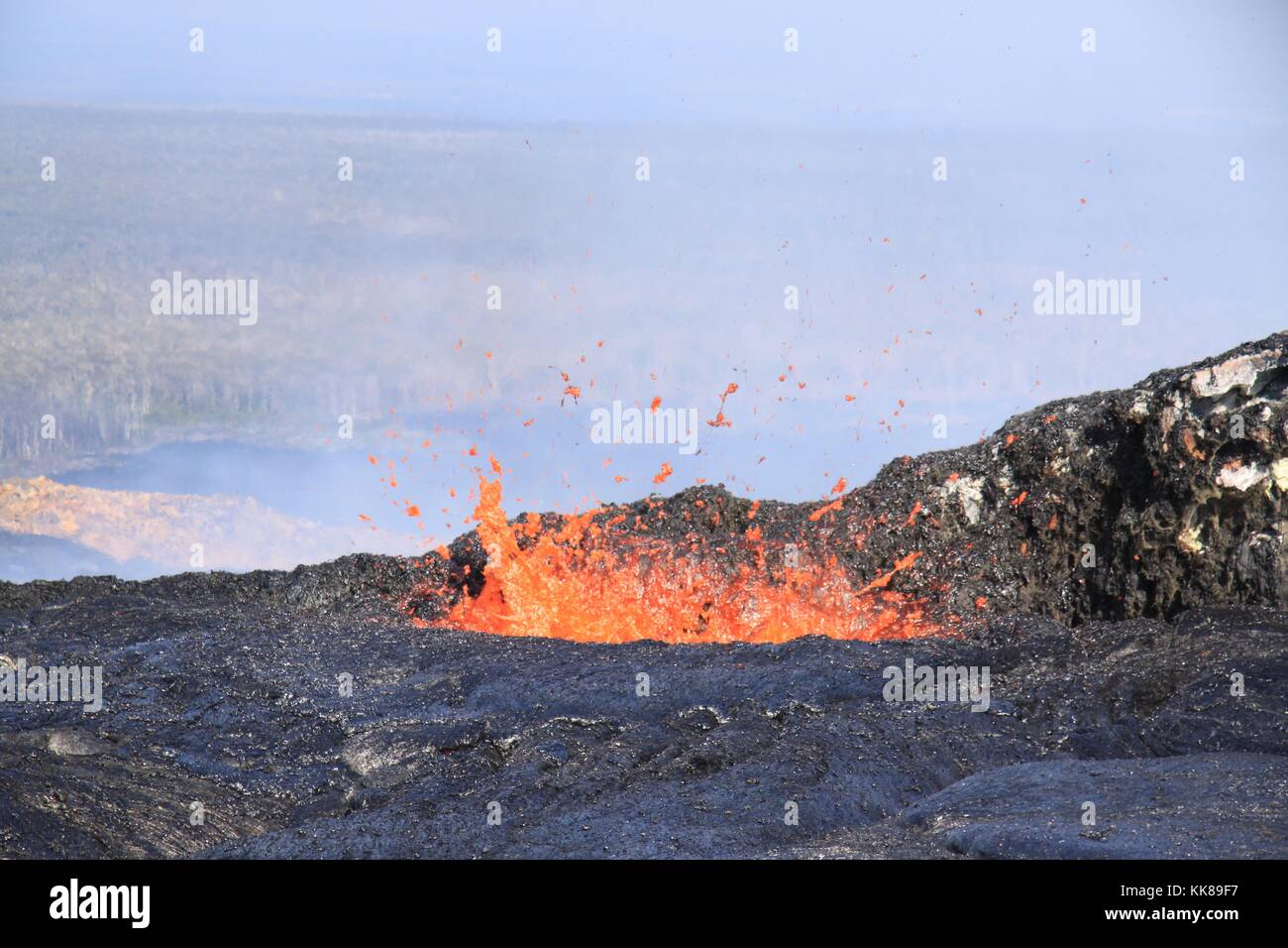 Volcanic activity on the lava pond of a volcano on Kilauea, Hawaii. This photo shows the lava pond at the northeast - Stock Image