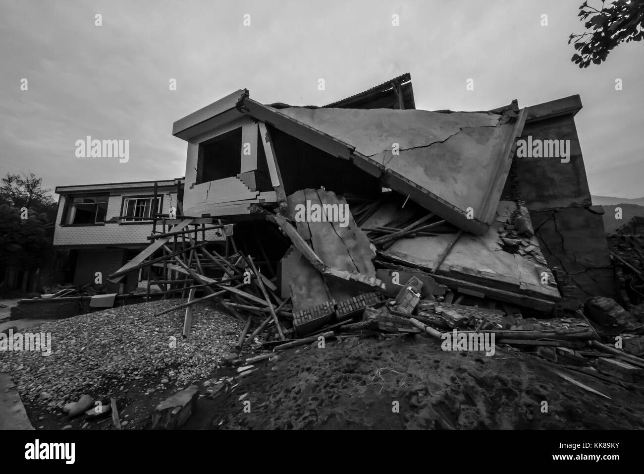 Damage to a village house in Sichuan, China after the magnitude 6.6 Lushan China Earthquake. Image courtesy USGS, - Stock Image