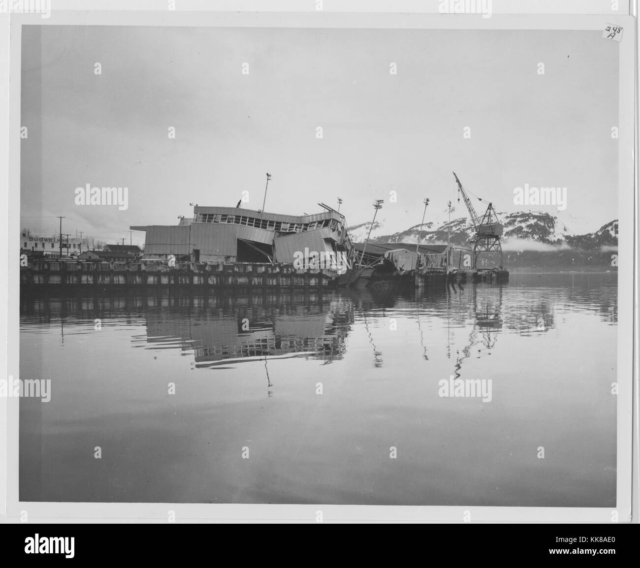 A photograph showing the damage that occurred to the dock in Seward due to the effects of the 1964 Alaska Earthquake, - Stock Image