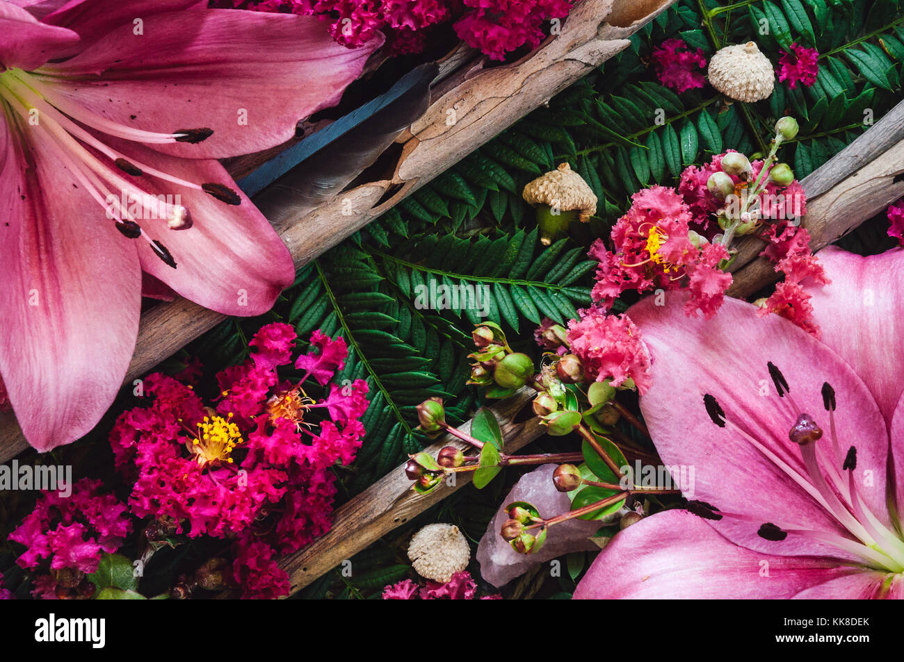 Lillies on a bed of Jacaranda with Acorns Stock Photo