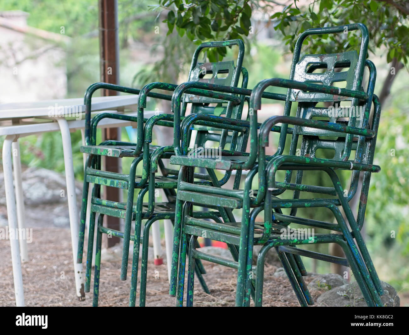 Oxidized steel chairs with white tables (outdoor) - Stock Image
