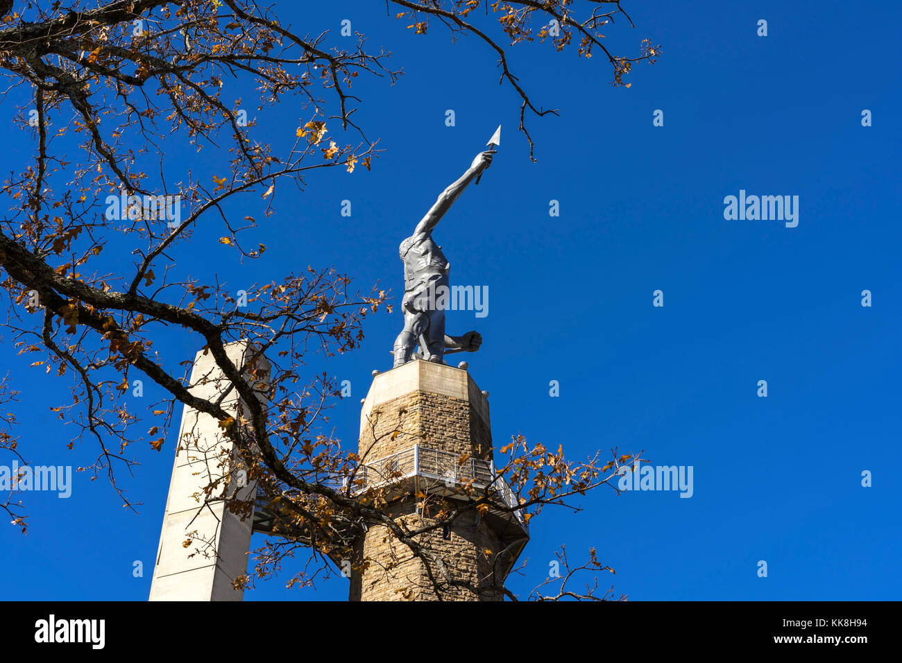The Vulcan statue at Vulcan park in Birmingham, Al. stands tall against a crisp, blue fall sky. Stock Photo