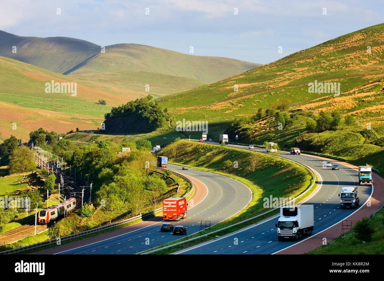 M6 motorway passing through east Cumbria hills, the Howgill Fells, 2 miles south of Tebay northwest England. Looking - Stock Image