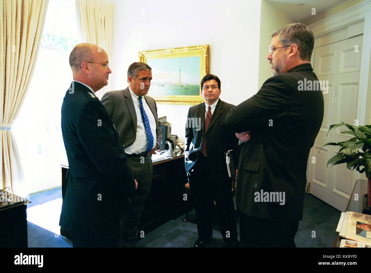 Former Chief of Staff to the Vice President David Addington Talks with Alberto Gonzales and George Tenet. Image - Stock Image