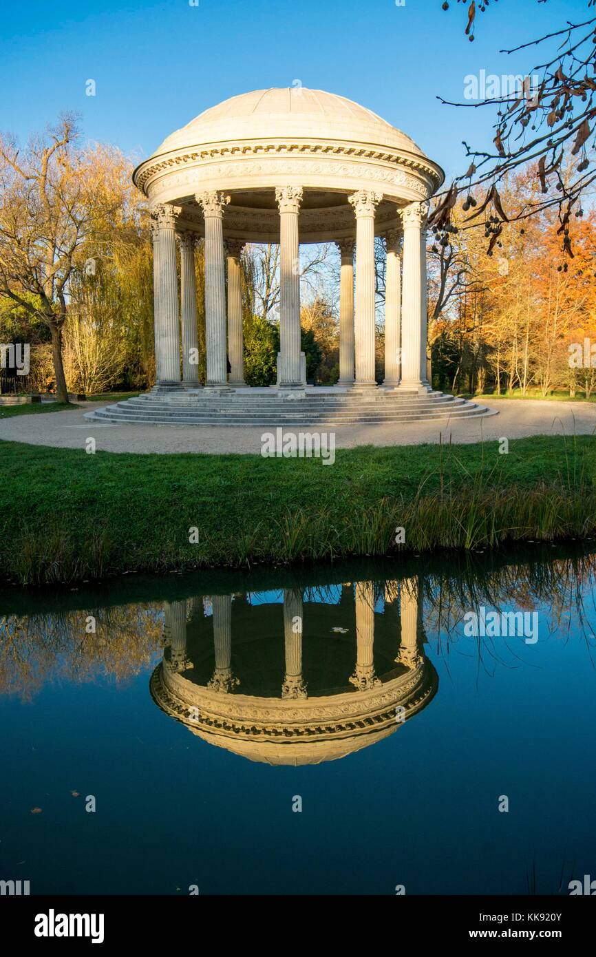 Palace of Versailles - Queen's Hamlet is a surprising beautiful setting. Lovely French garden architecture. Stock Photo