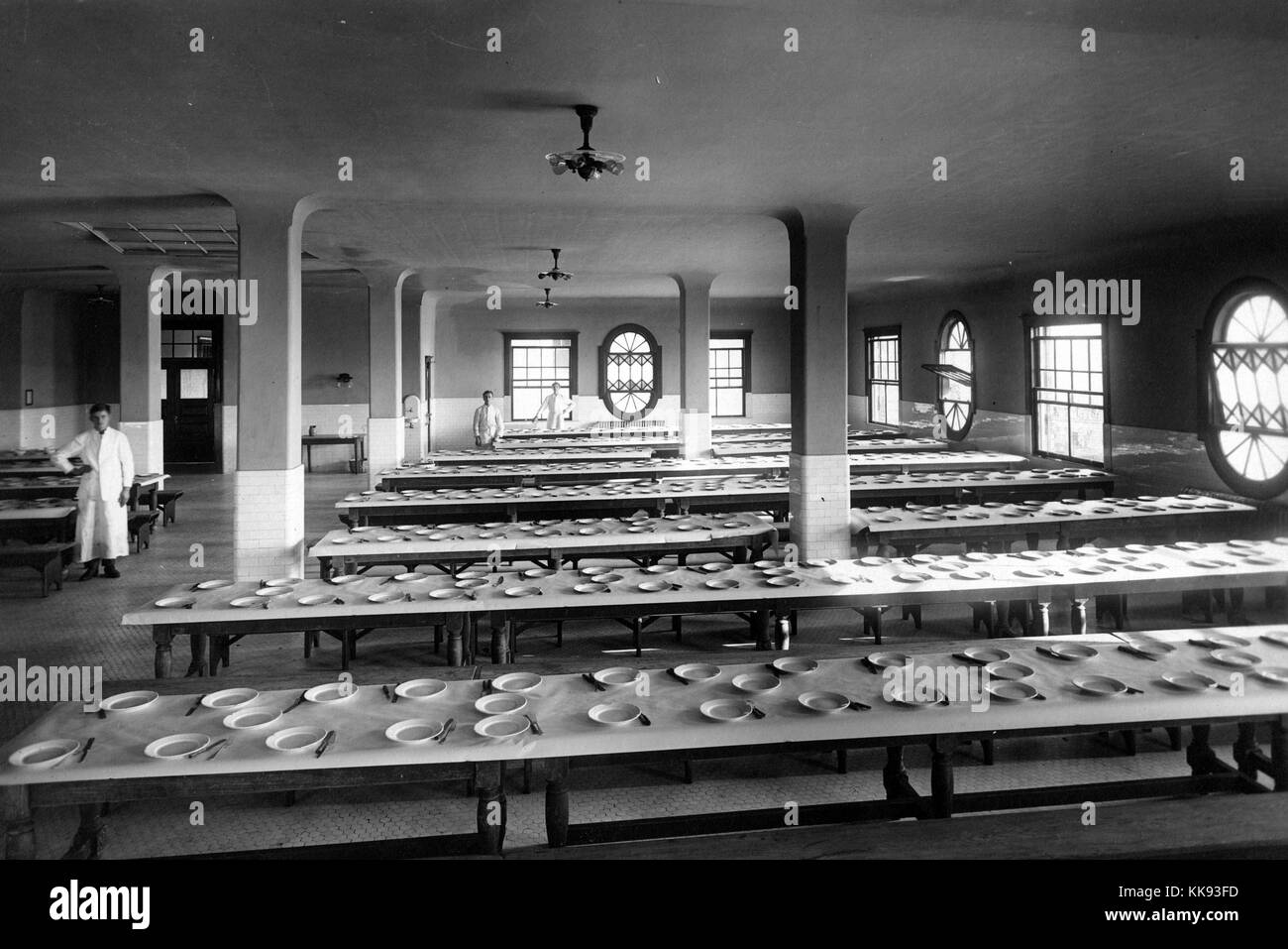 Black and white photograph of the dinning hall on ellis island