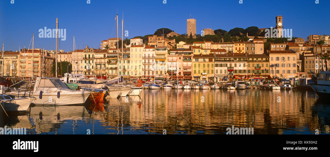 The Old harbour and Le Suquet in early morning sunlight, Cannes, Cote d'Azur, French Riviera, France - Stock Image