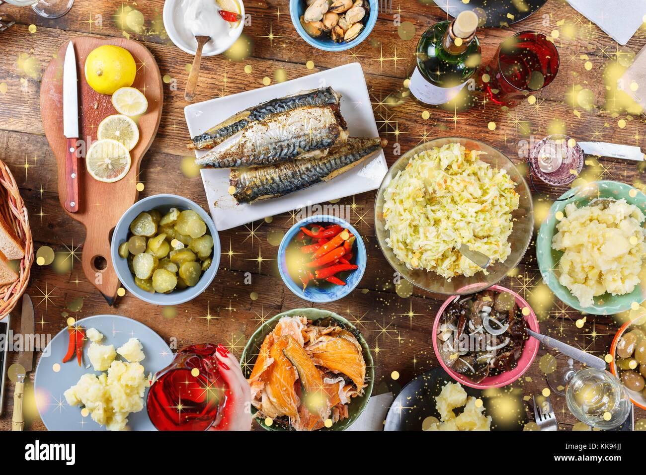 Christmas dinner with family traditional snacks and wine falling christmas dinner with family traditional snacks and wine falling golden snowflakes top veiw forumfinder Image collections