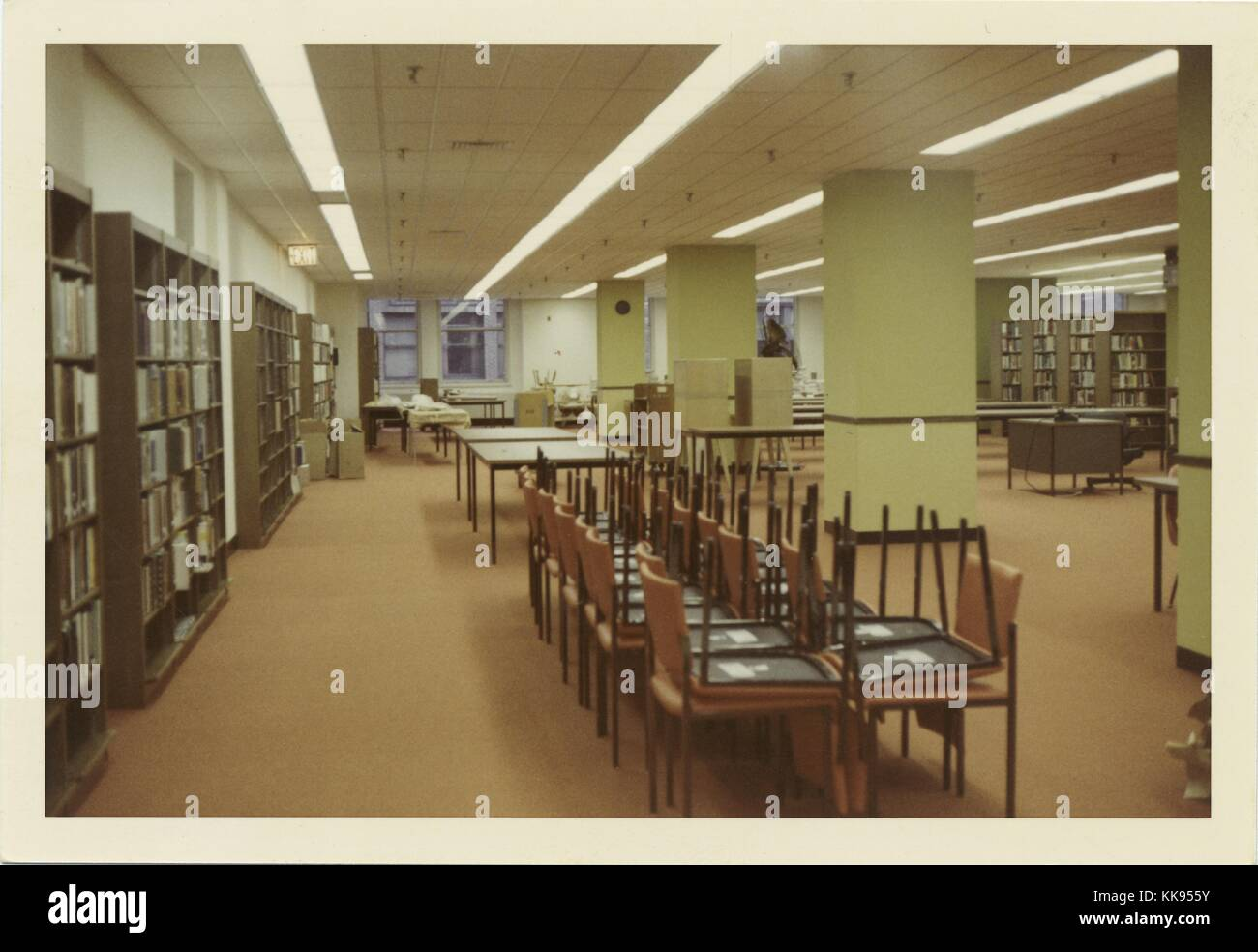 Color photograph of a large library reading room, chairs up, New York City, New York, 1970. From the New York Public - Stock Image