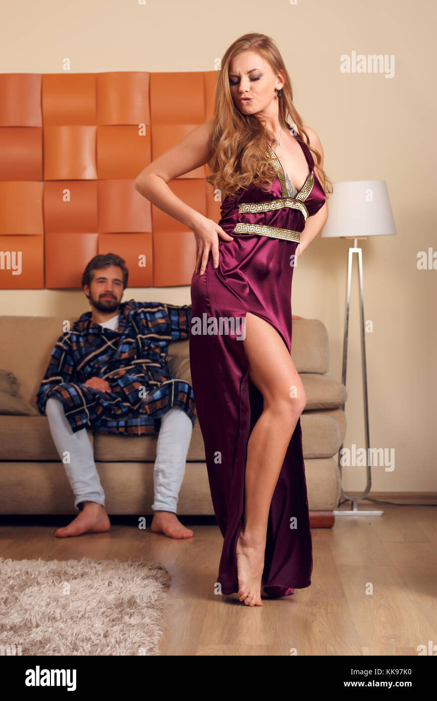 ef2033808 Image of dancing blonde in long negligee and men in dressing gown - Stock  Image