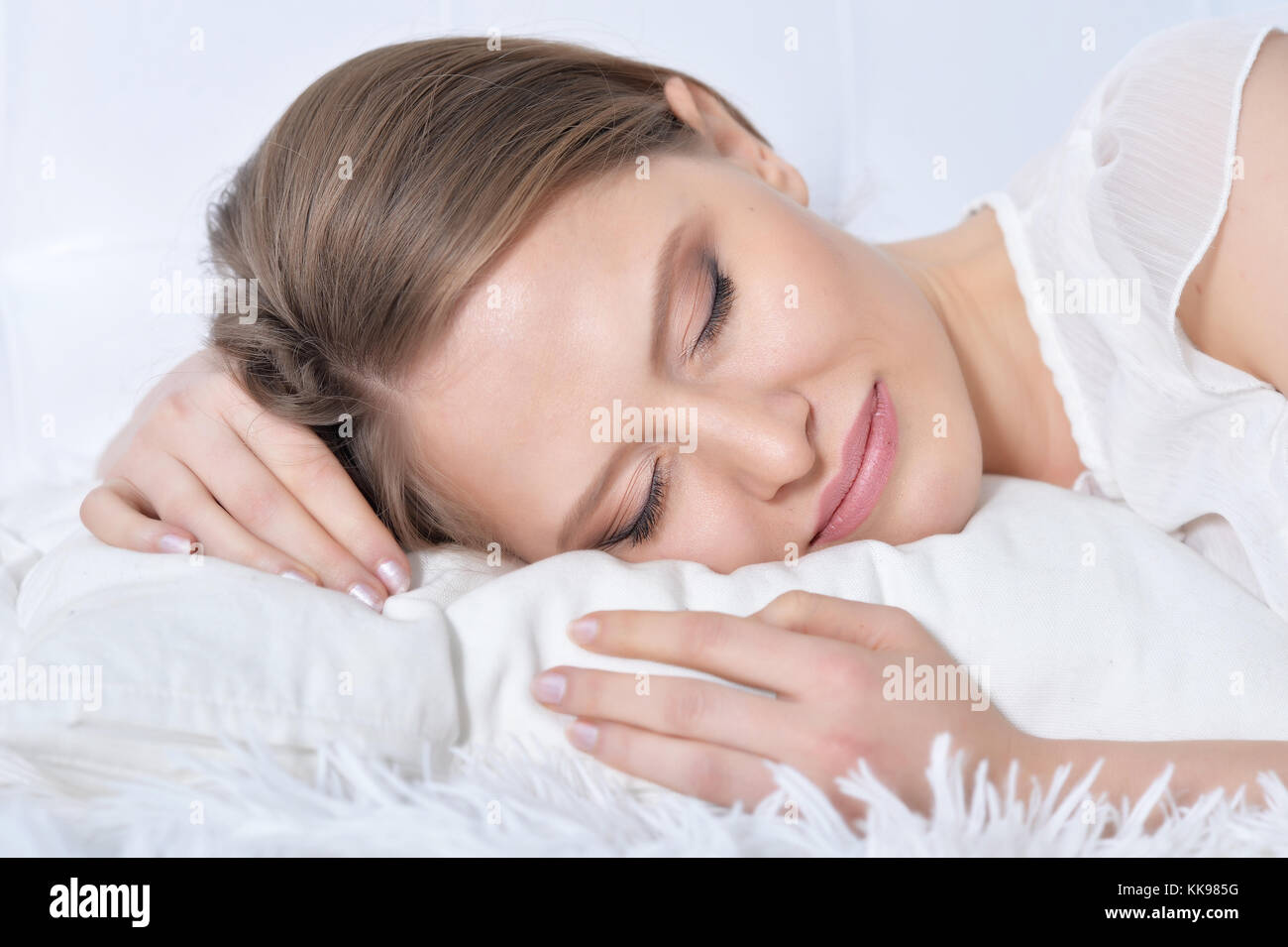Young woman sleeping in bad Stock Photo