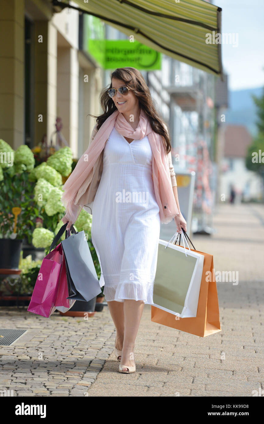 A woman is doing her shopping in the city. (model released)   usage worldwide - Stock Image