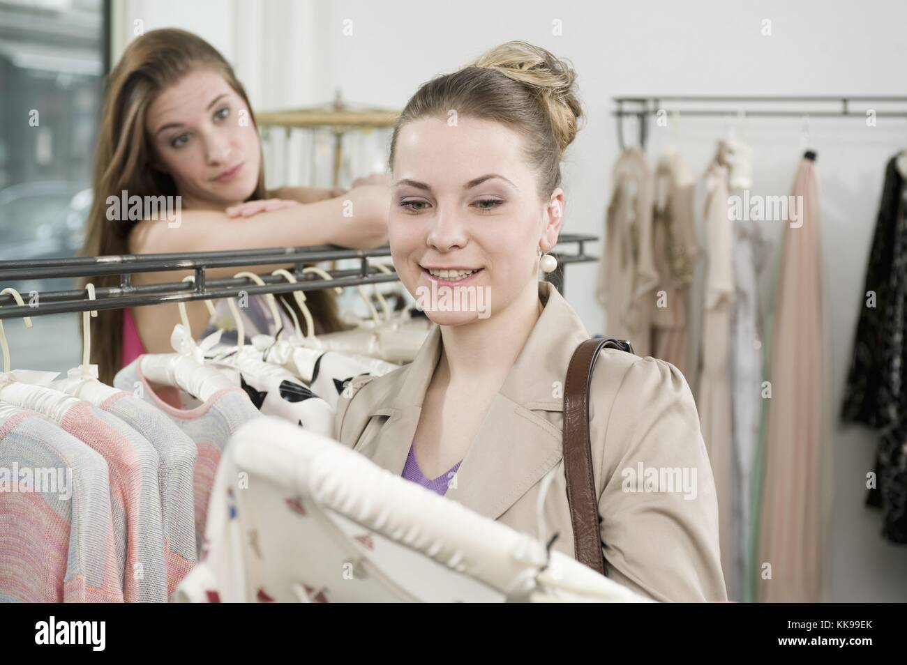 Sales girl with customer in fashion store | usage worldwide, Royalty free: For comercial usage price on demand. - Stock Image