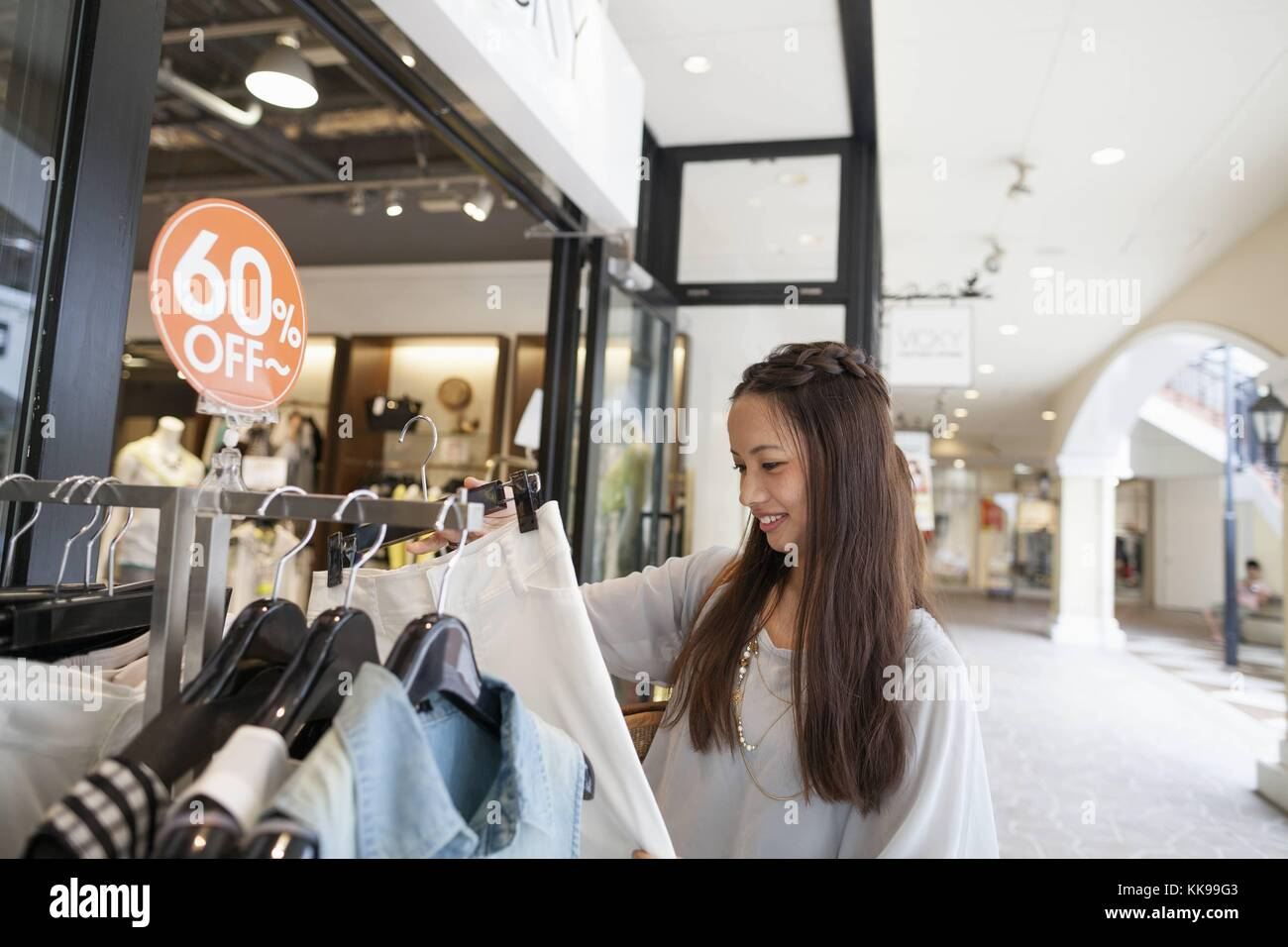 Young woman on a shopping trip. | usage worldwide, Royalty free: For comercial usage price on demand. - Stock Image