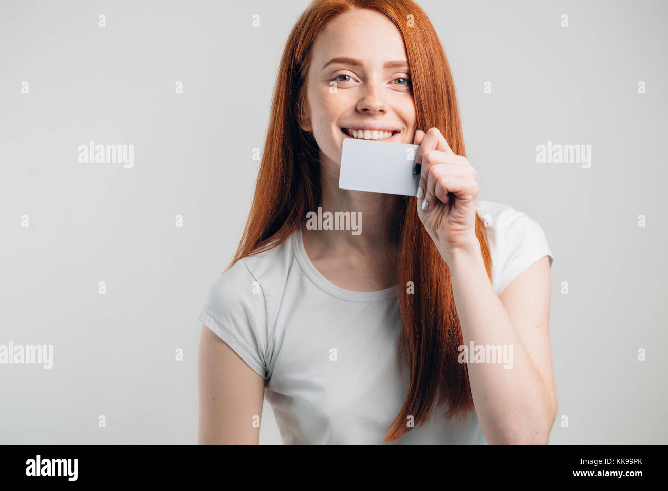people, sale and consumerism concept - close up of happy woman with credit card. - Stock Image