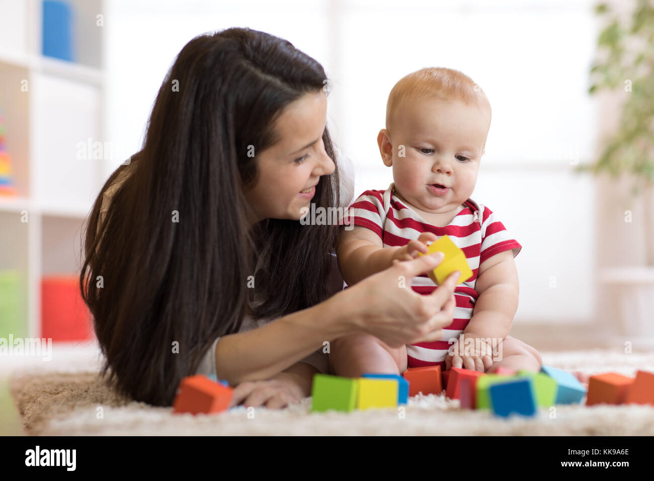Mother with baby boy playing at home - Stock Image