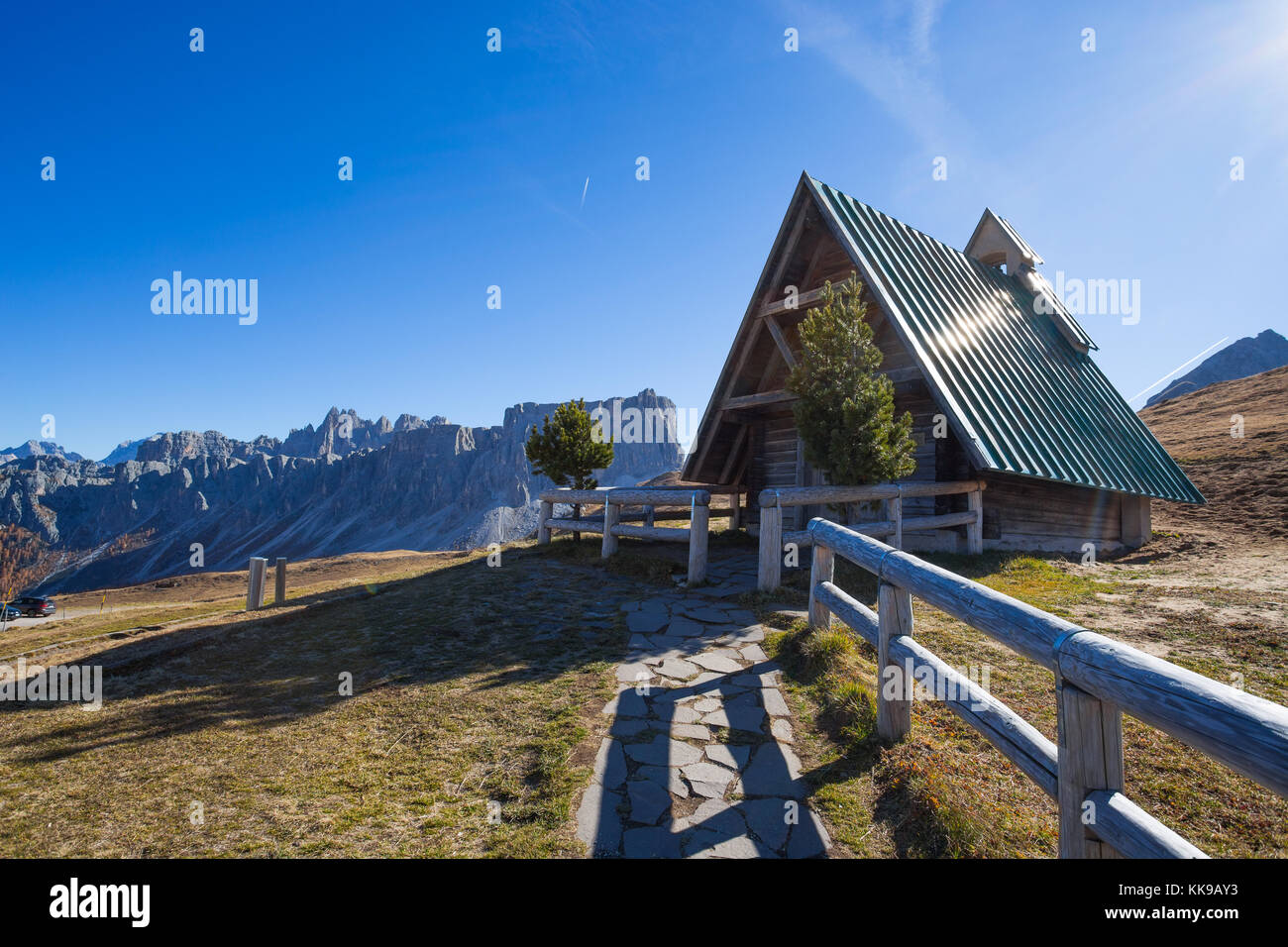 The small church at Giau pass, an alpine Dolomites pass at 2236 metres in Belluno province that connects the villages - Stock Image