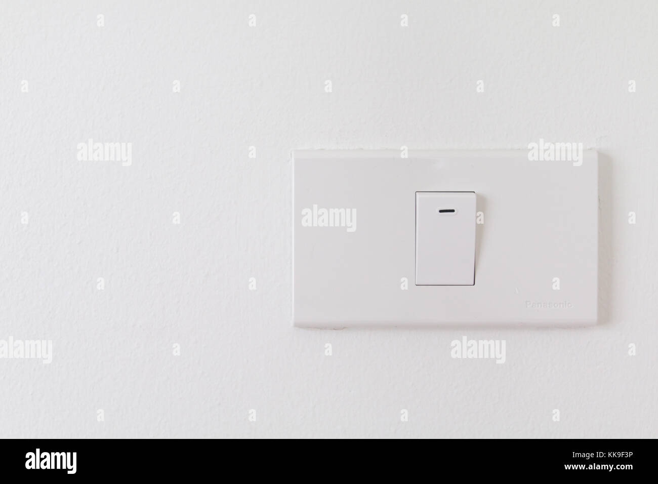 Electronic switches with white background, White switches on wall in ...