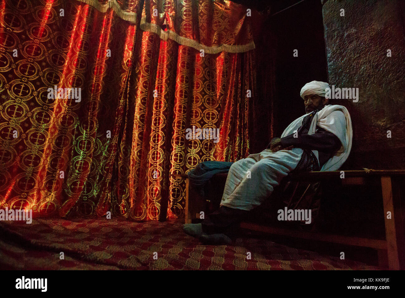 Priest in a rock hewn church in Lalibela, Ethiopia - Stock Image