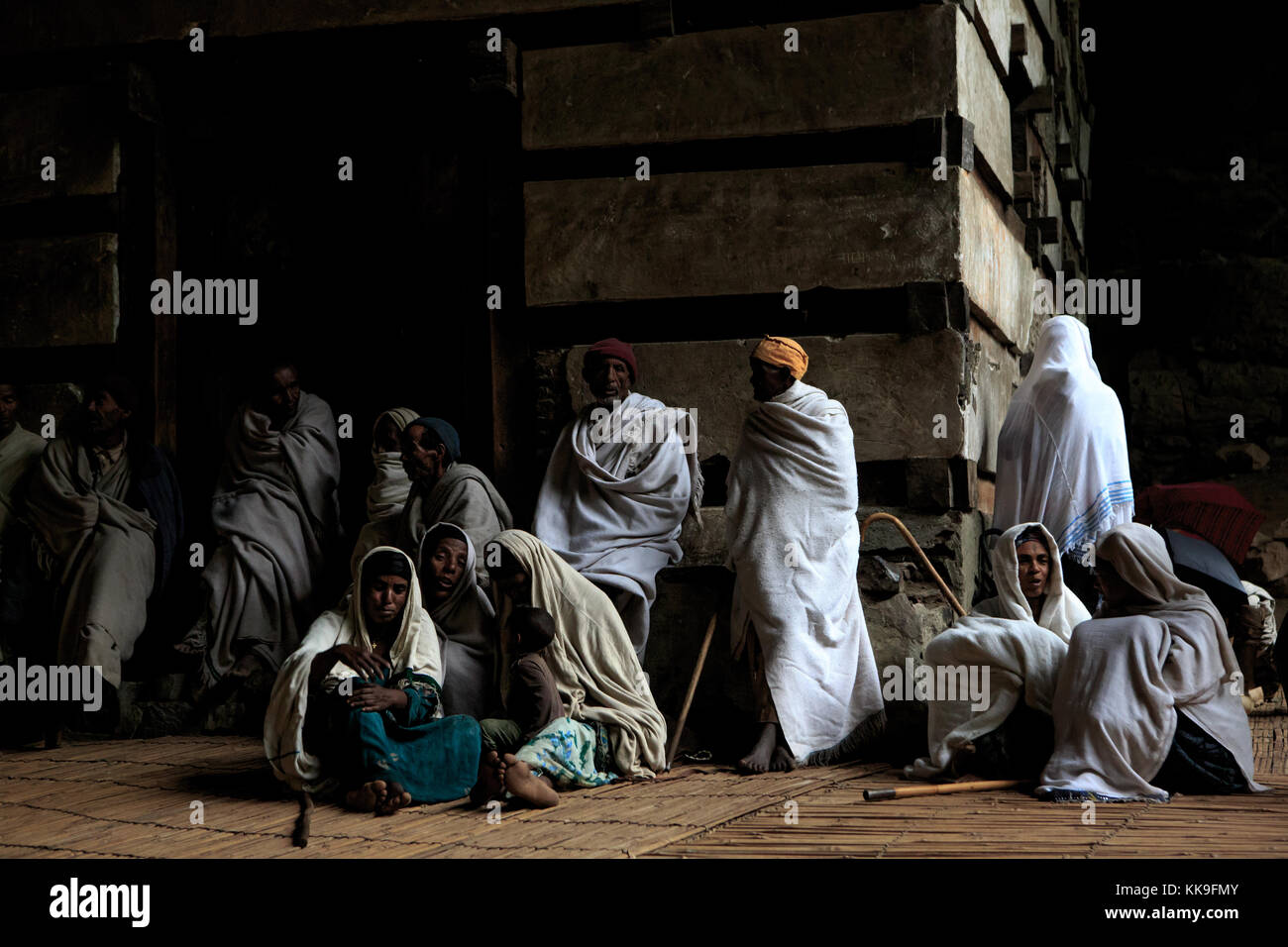 Believers at Yemrehana Krestos Church, an impressive cave church near Lalibela, Ethiopia. - Stock Image
