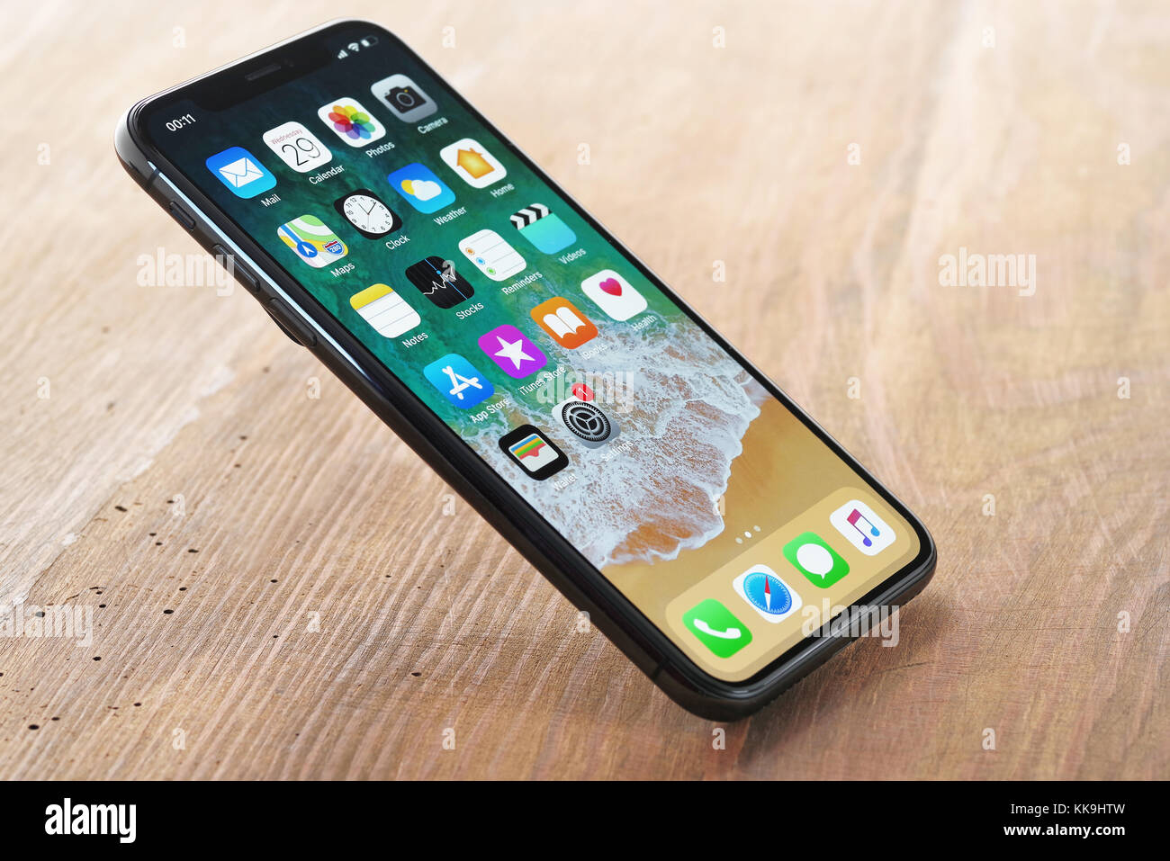 Koszalin, Poland – November 29, 2016: Space gray iPhone X on white background. The iPhone X is smart phone with - Stock Image