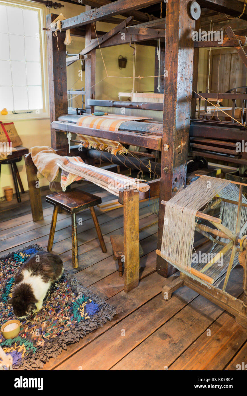 An important exhibit in Trowbridge museum showing a Cottage weaving loom one of many which supplied the woolen mills - Stock Image