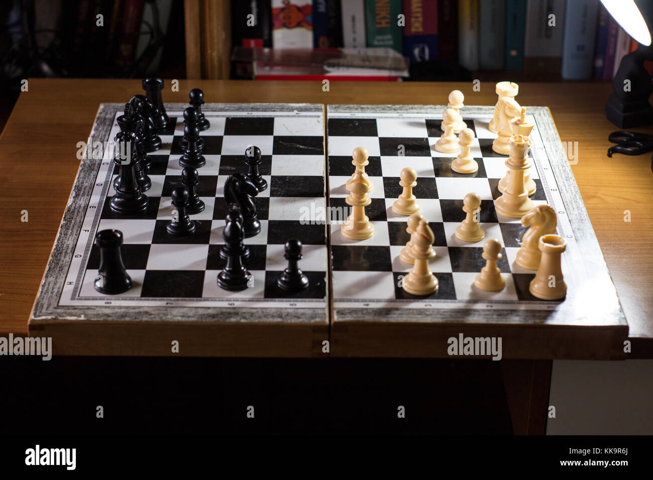 chess board from the side with multiple moves made game - Stock Image