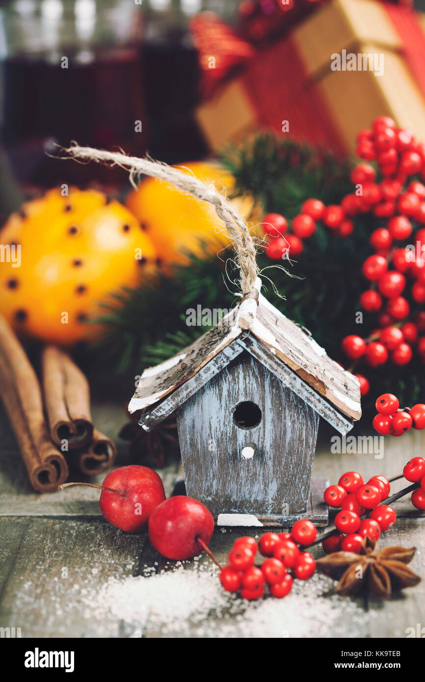 Bright christmas composition with small bird house and mulled wine - Stock Image