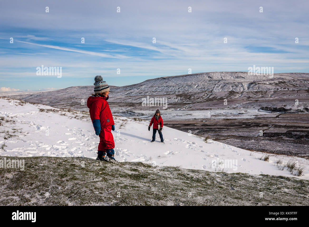 Children playing in the winter snow on Pen Y Ghent (694m), Yorkshire Dales England - Stock Image