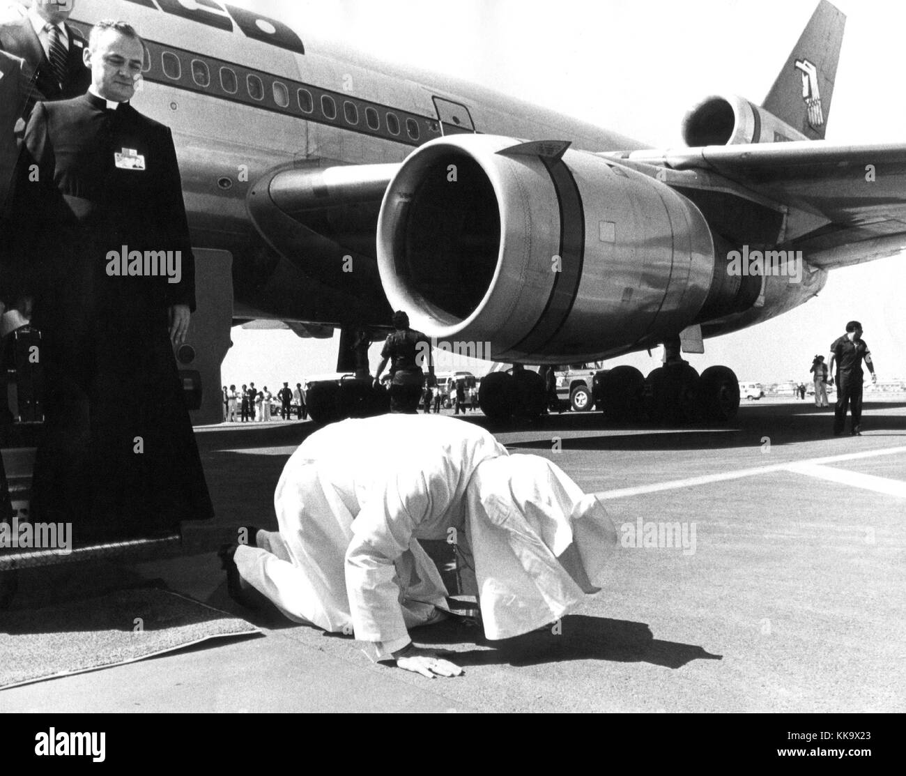 Pope John Paul II kneels down and kisses the ground after his arrival at Mexico Town Airport. pictured on 26th January Stock Photo
