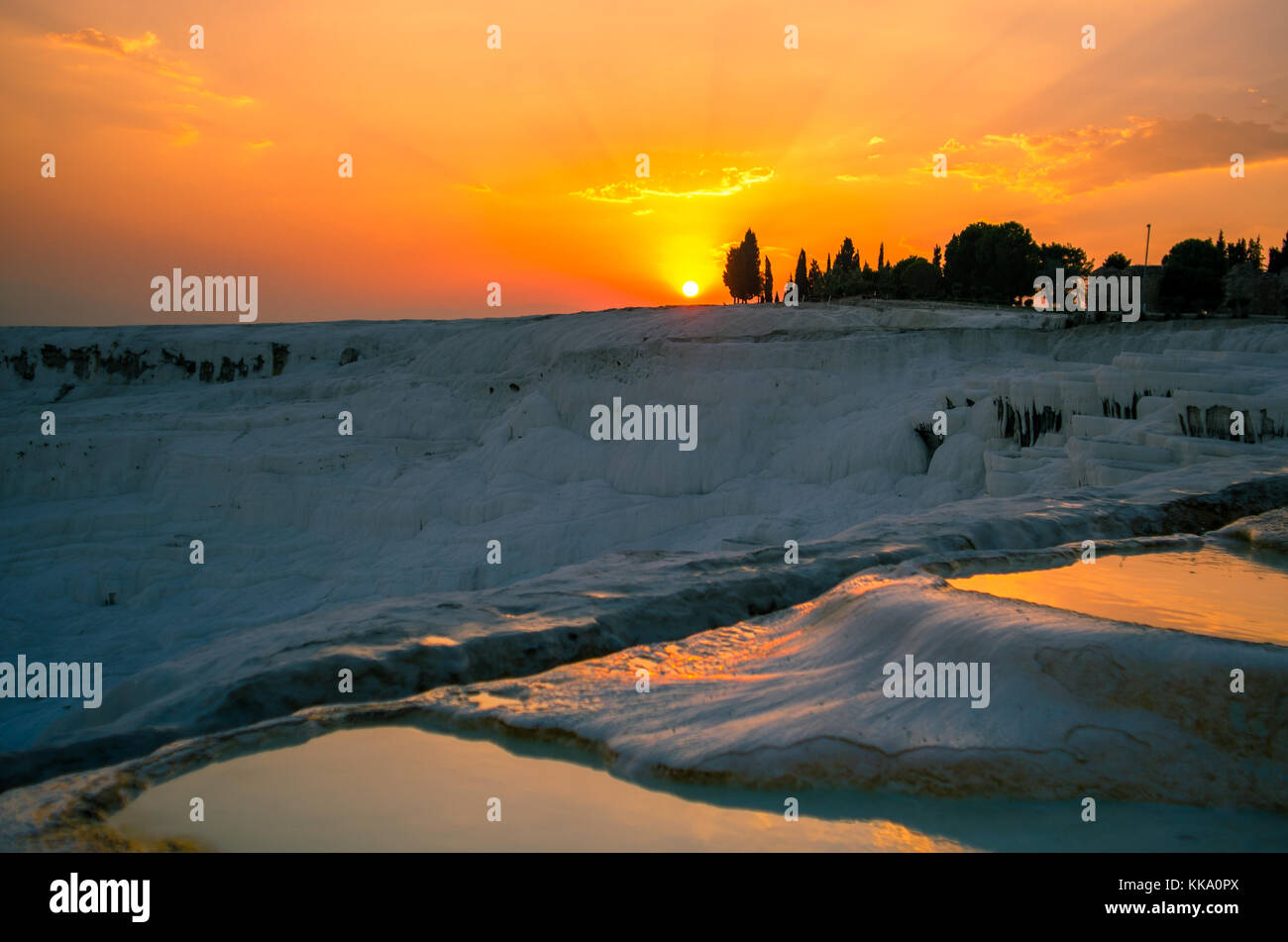 Sunset over the travertines of Pamukkale, Turkey - Stock Image