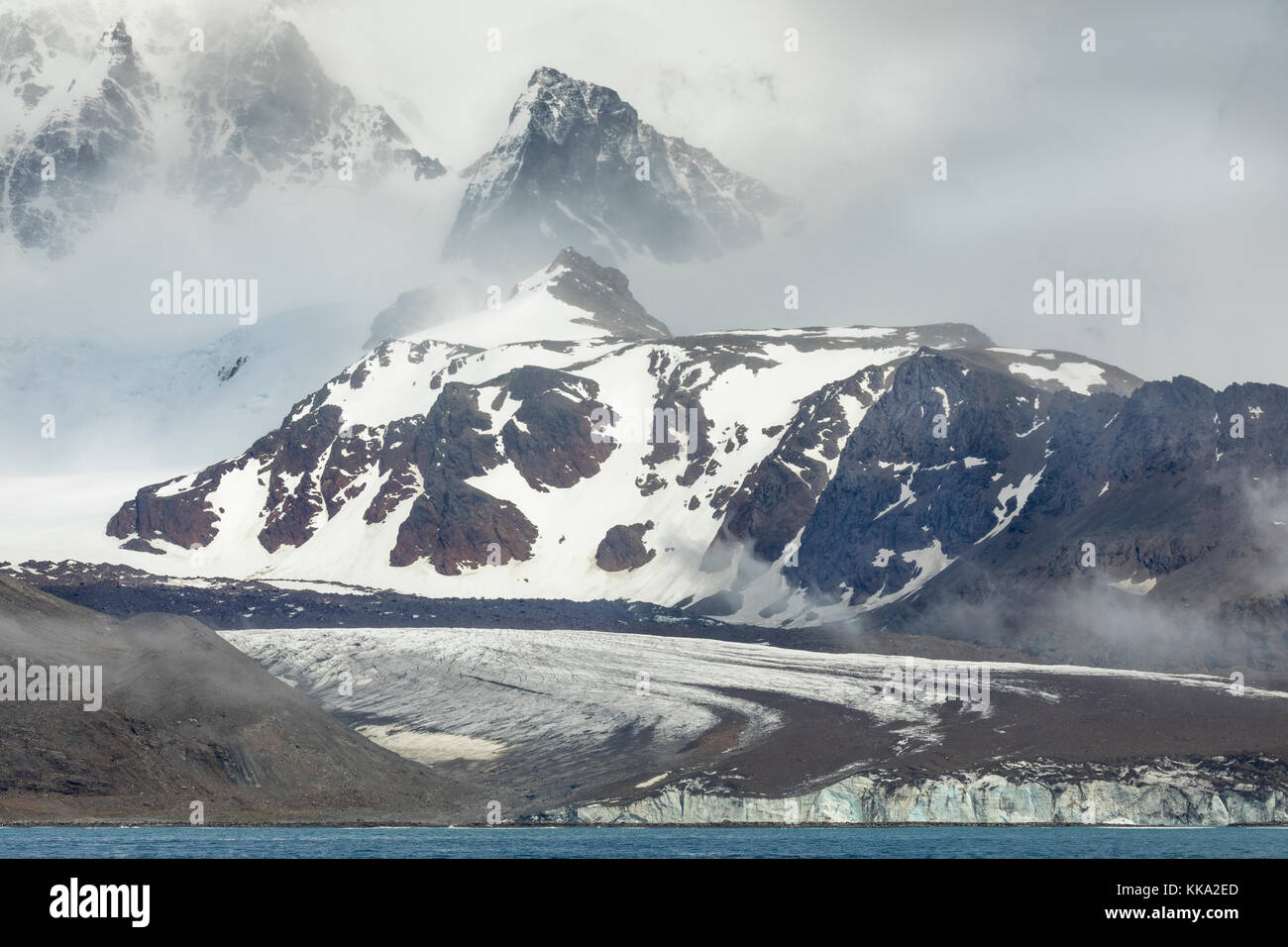 Snow-capped mountains and glacier at St Andrew's Bay, South Georgia Island - Stock Image