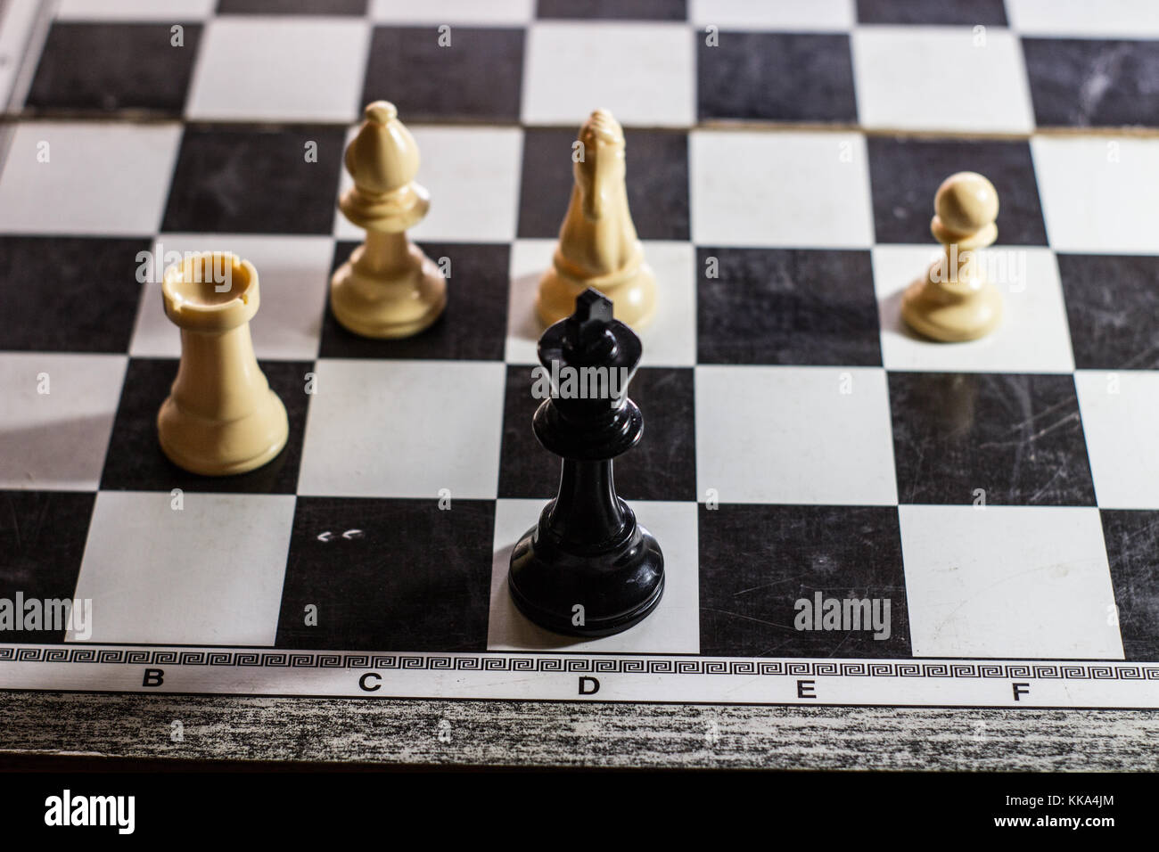 stalemate move on a chessboard with the king cornered end game - Stock Image