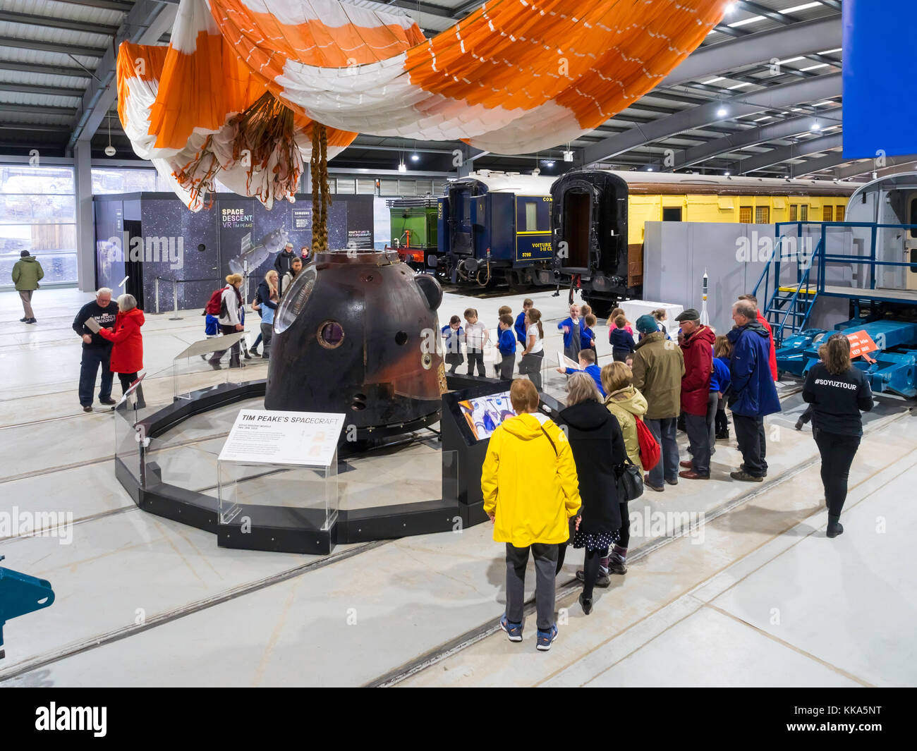 Crowd of people and children viewing Soyuz Descent Module TMA-19M which brought  Astronaut Major Tim Peake down - Stock Image
