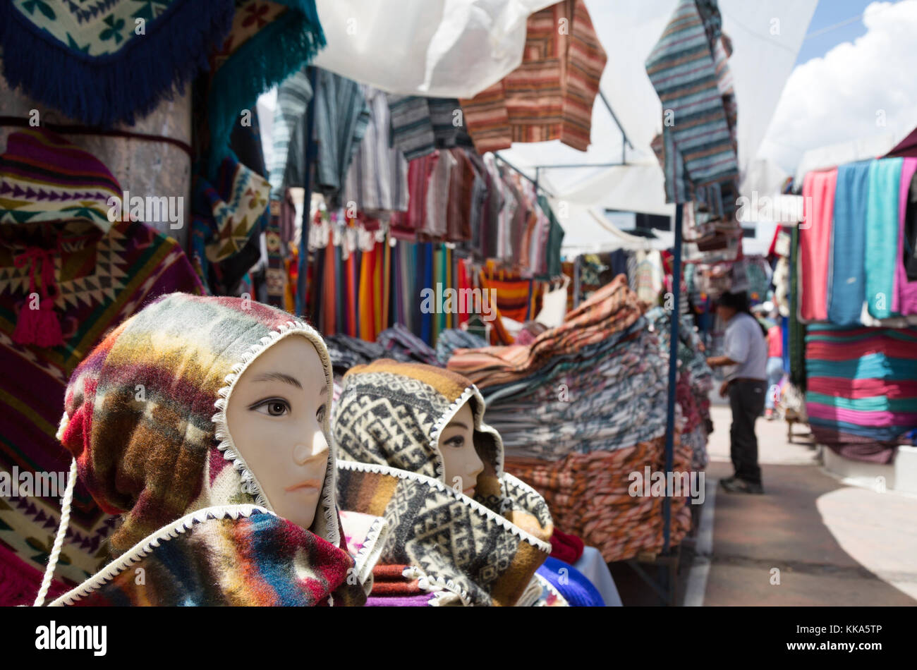 Otavalo market Ecuador, colourful textiles for sale in a market stall, Otavalo market, northern Ecuador, South America - Stock Image