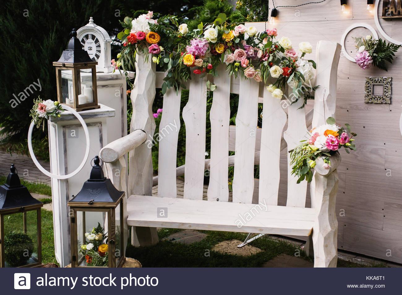 Beautiful unusual wedding decor rustic style bench wall of stock beautiful unusual wedding decor rustic style bench wall of flowers lanterns at the photo zone junglespirit Choice Image