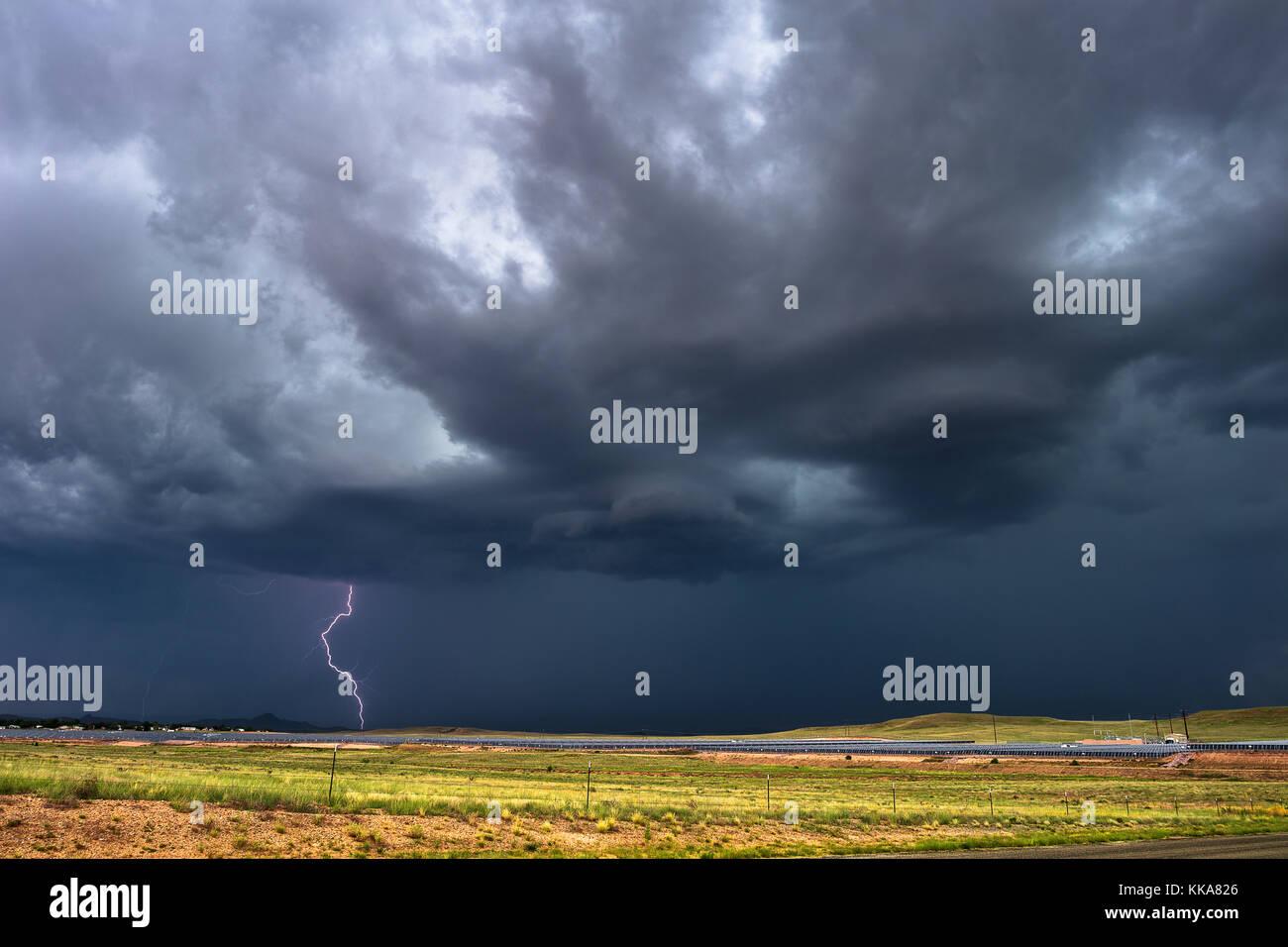 Summer thunderstorm with lightning and dark clouds near Chino Valley, Arizona, USA. Stock Photo