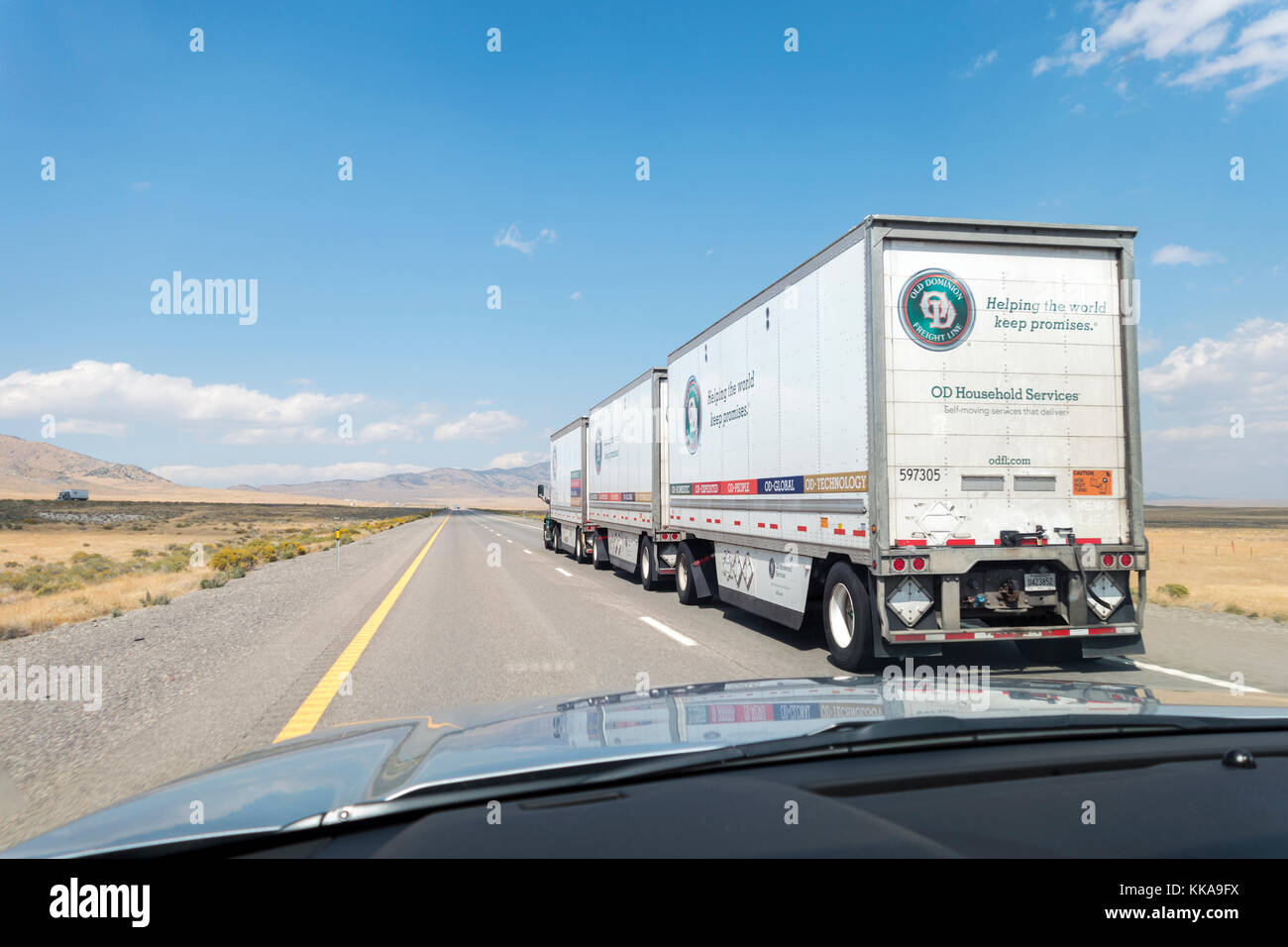 Old Dominion Freight Line Triple Trailer Combination Road Train on Interstate I-80 in Nevada - Stock Image