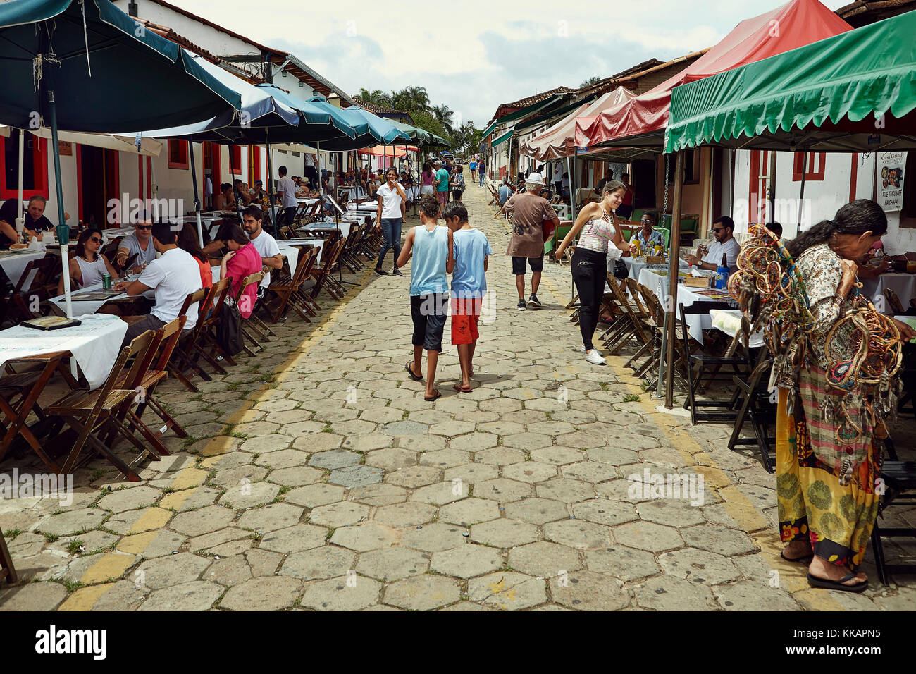 Street lined with outside restaurants in the old town of Pirenopolis, in the Brazilian state of Goias, Brazil, South - Stock Image