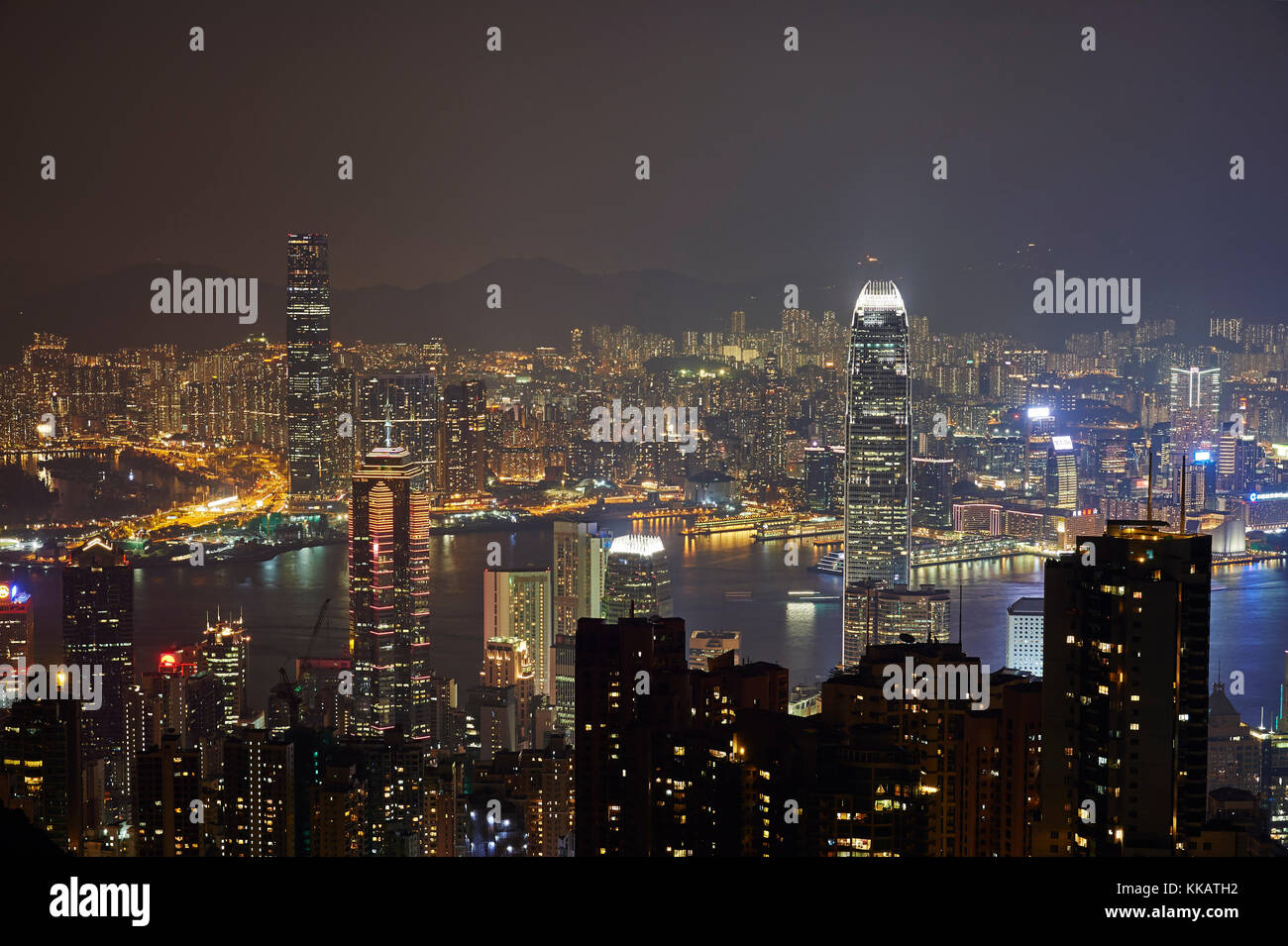View at night of central Hong Kong and Victoria Harbour from Victoria Peak, looking toward Kowloon in background, - Stock Image