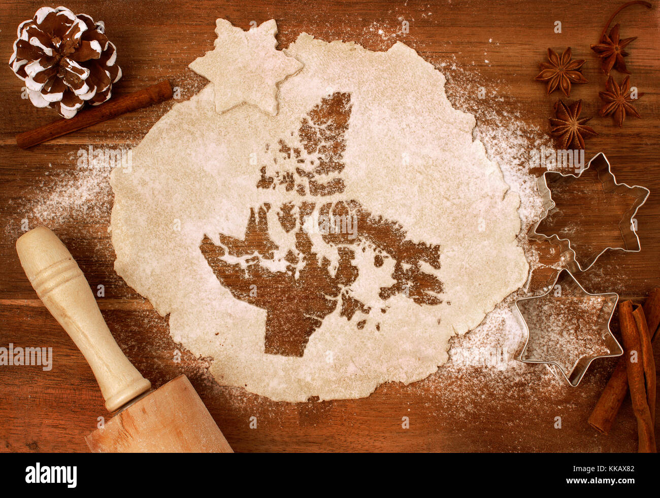 Festive cookie dough with the shape of Nunavut cut out (series) - Stock Image