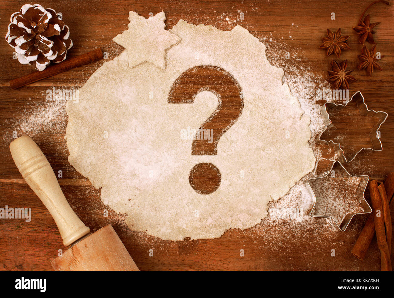 Festive cookie dough with the shape of a question mark cut out (series) - Stock Image