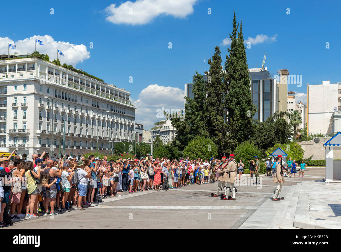 Tourists watching the changing of the guard at the Tomb of the Unknown Soldier, Syntagma Square, Athens, Greece Stock Photo