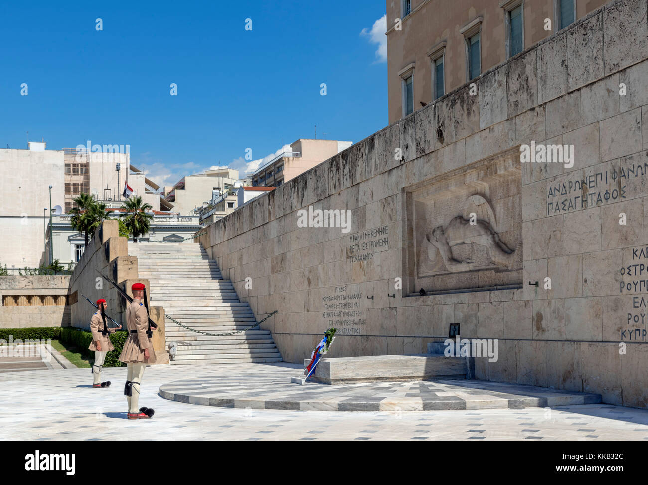 Evzones (Presidential Guard) guarding the Tomb of the Unknown Soldier in front of the Greek Parliament building, - Stock Image